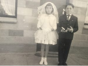 Photo of William and his sister taken in front of their home in Renmark in 1961 on the occasion of their First Holy Communion.